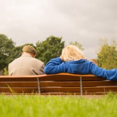 senior couple sitting on bench